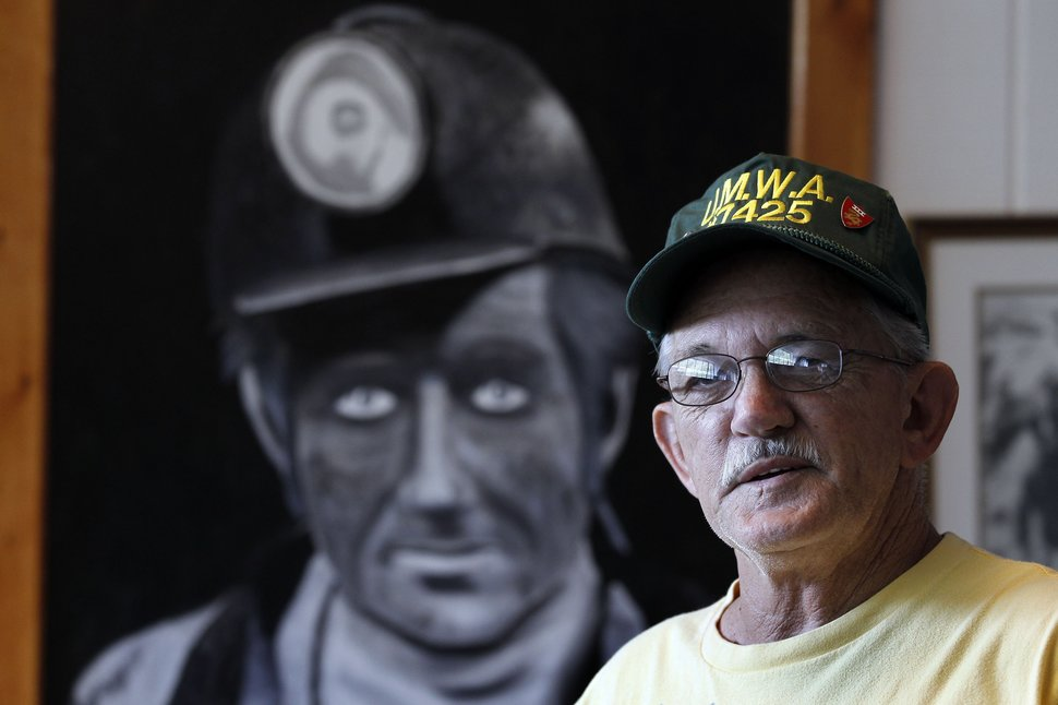 Carl Shoupe by a painting of a coal miner in the Kentucky Coal  Mining Museum in Benham, Ky., Tuesday, August 16, 2011. The first  load of coal shipped by rail from Harlan County was shipped in  August 1911, 100 years ago. Charles Bertram | Staff