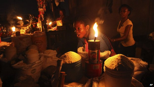 A-Lagos-Trader-selling-her-goods-in-the-darkness.-Photo-AP