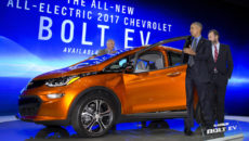 President Barack Obama steps from the new Chevrolet Bolt electric car as Dan Ammann, President, General Motors Company, stands right and Patrick Foley, controls manager for the Bolt EV at GM in Detroit, stands left, during a tour of the 2016 North American International Auto Show in Detroit, Wednesday, Jan. 20, 2016, to highlight the progress made by the American auto industry. (AP Photo/Carolyn Kaster)