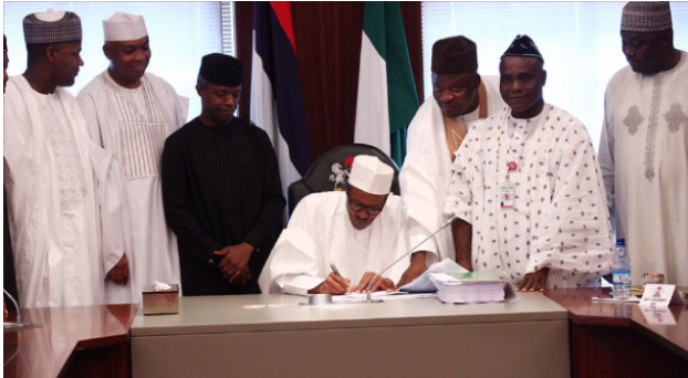 buhari-finally-sign-2016-budget-into-law-1