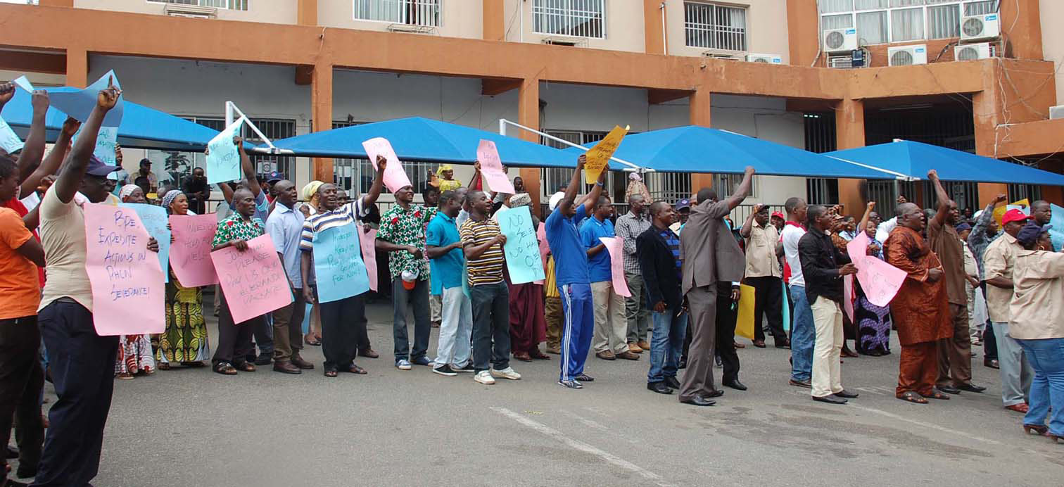 PIC. 11. PHCN WORKERS PROTESTING  THE TAKE OVER OF THE COMPANY BY INVESTOR WITHOUT PAYING THEIR   SEVERANCE BENEFITS AND SETTLEMENT OF OTHER LABOUR ISSUES BY FEDERAL GOVERNMENT  IN ABUJA ON   MONDAY  (30/9/13).