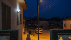 Febrary 29, 2016 - Ayeldu, Ghana: an old man looks out at the village at dusk, when the lights finally returned after being out all day.